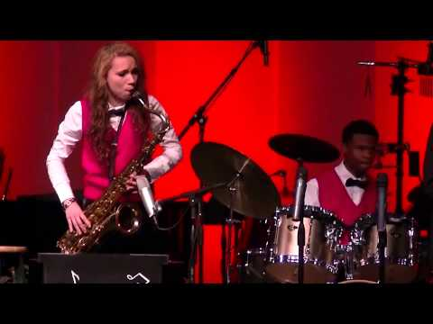 Playing tenor Saxophone as a teenager.