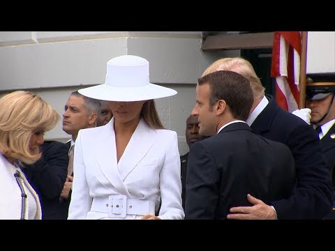 Melania Trump's big white hat steals the show in state visit from French president and his wife