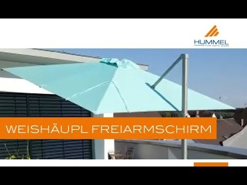 On location: Weishäupl Freiarmschirm   HUMMEL Blockhaus