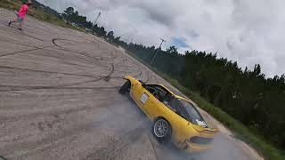 Chasing drift cars with an FPV drone.