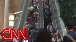Chaos on mall escalator