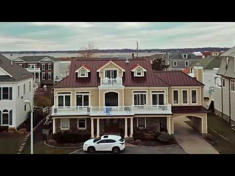 This custom standing seam metal roof at the NJ Shore features a 100% Aluminum panel that will not rust, rot or corrode and best of all it looks AMAZING! At Global Home, we fabricate all of our metal roofing panels and flashing accessories on site ensuring a perfect fitting roof every time! Check out this drone video that shows the detailed work that goes into a custom Standing Seam Metal Roof Installation by Global Home Improvement. For your free estimate call us today at 888-234-2929...serving PA, DE, and NJ.