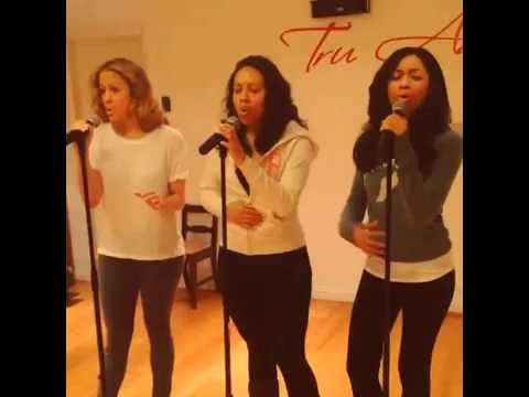 Getting an all-female R&B vocal group warmed-up before a big show.