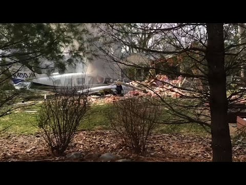 A small plane crashed into a suburban Cincinnati house Tuesday afternoon, killing the pilot and sending dark smoke billowing from the backyard. (March 13)