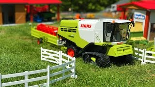 BRUDER TOYS - two combine harvesters and tractors with trailers at work!