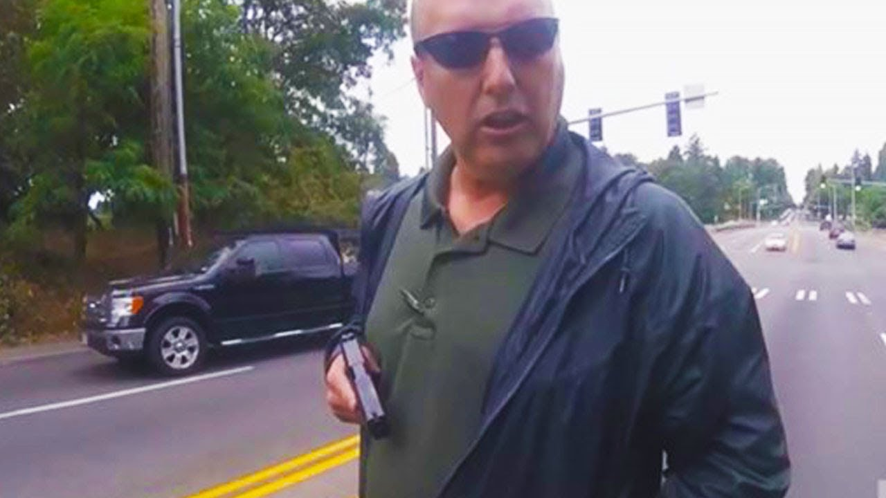 Cop Pulls Gun On Biker (VIDEO) thumbnail