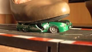 Ximenia crushes a slotcar on a racetrack (crush crushing stomp stomping zertreten ecrasement)