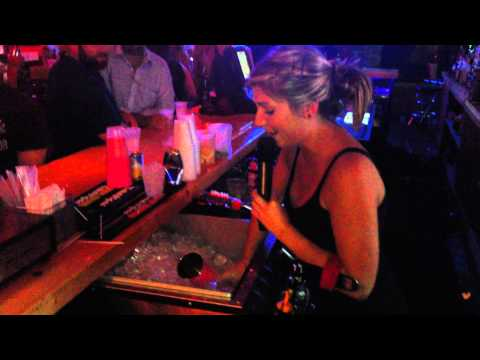 amazing multitasking bartender sings karaoke and doesnt miss a beat...or a drink order