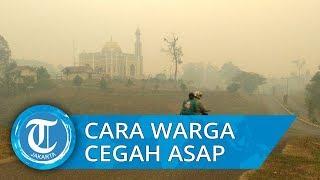 Warga Kumpeh Ilir Hidupkan Kipas Angin untuk Hindari Kabut Asap