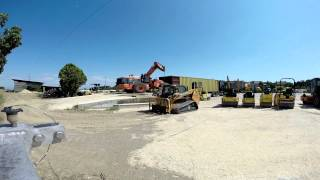 Wheel Loader Hitachi ZW220 Loading In A Container