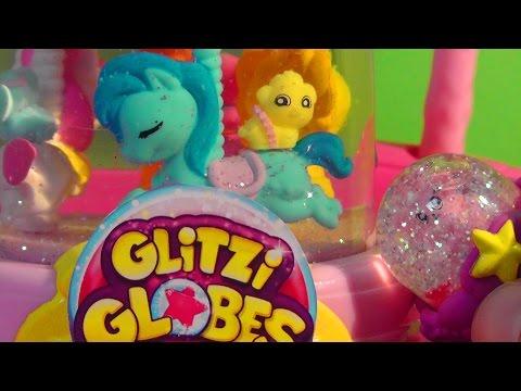 GLITZI GLOBES Carrusel de bolas de purpurina. video en español.