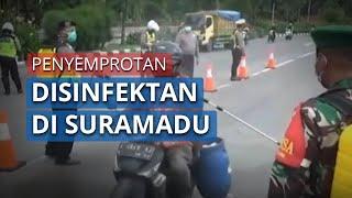 Polda Jawa Timur Lakukan Penyemprotan Disinfektan di Jalur Suramadu