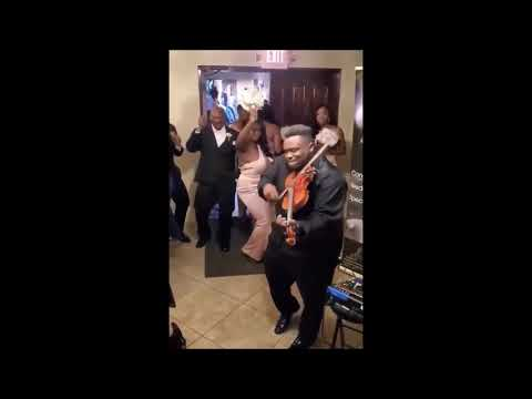 Violinist laying down Choppa Style at a wedding