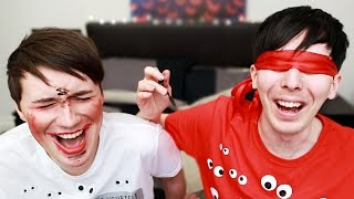 DAN AND PHIL BLINDFOLDED MAKEUP CHALLENGE