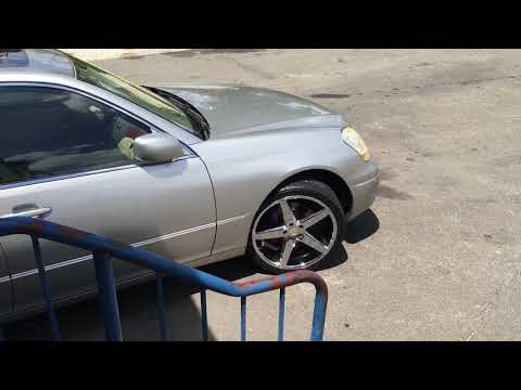 "2003 Lexus LS 430 sitting on 20"" rosso affinity chrome wheels and 245/35-20 lexani tires"