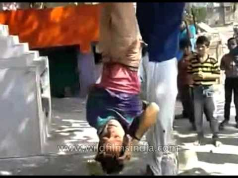 Graphic and disturbing : Boy hung upside down, beaten with stick as