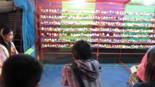 preview picture of video 'Shooting cans at a nightime fun fair Loei and surrounding areas in Isaan , Eastern Thailand'