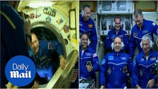 Two US astronauts and Russian cosmonaut arrive at ISS - Daily Mail