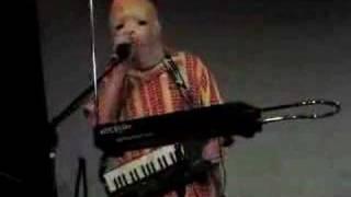 Mark Mothersbaugh as Booji Boy sings U Got Me Bugged with member of Fartbarf