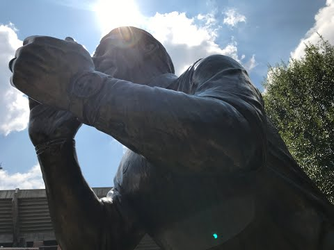 Solar eclipse darkens Nick Saban statue, Bryant-Denny Stadium