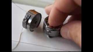 Как вытащить шпульку из шпульного колпачка