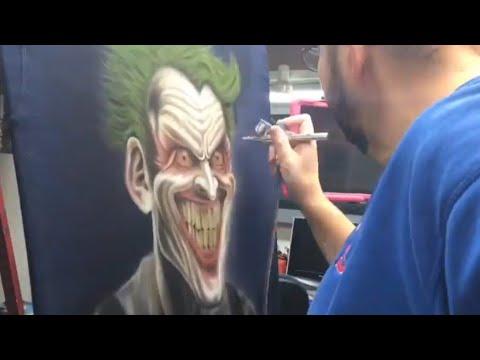 Airbrush Joker from Batman Arkham asylum on shirt, painting on dark fabric