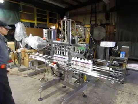 Semi-Automatic inline filling machine Bottle filler sold by Filling Equipment Co., Inc.