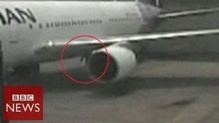 Video: Stowaway emerging from plane wheel - BBC News