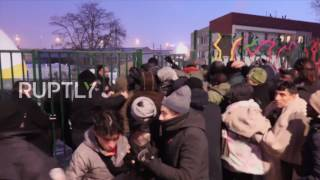 France: Refugees kept out in cold break past barriers to reach Paris reception centre