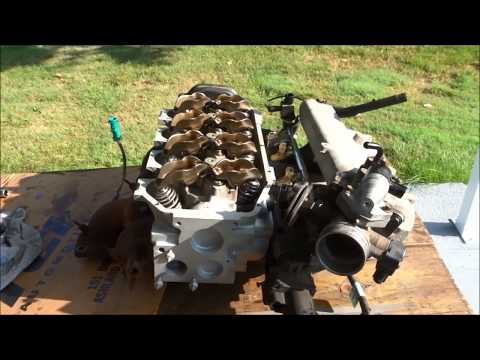 1998 Ford Escort intake valve seat damage repair. Rebuilt head installed