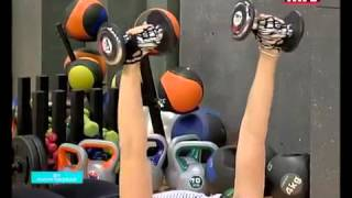 Full body workout using a Swiss ball and a pair of dumbbells