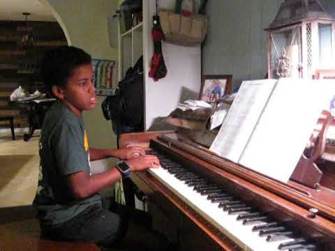 My student is playing Monster's Midnight March, by Nancy Faber. He played so well that he scared the dog!