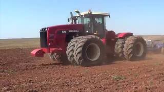 Versatile 575 Tractor pulling a 64 foot chisel plow - Munday Texas