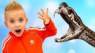 ОДИН в клетке с УДАВОМ... Kid in a cage with a anaconda...