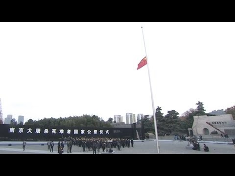 Full video: Chinese flag at half-mast for massacre victims