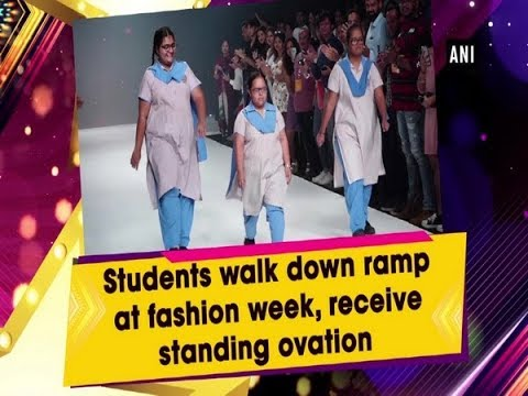 Students walk down ramp at fashion week, receive standing ovation