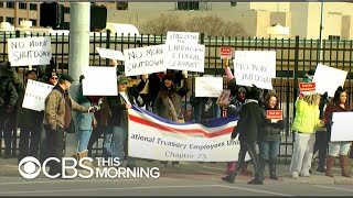 Federal workers stage protests against government shutdown