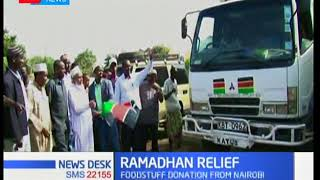 Muslim faithful donate food to underprivileged