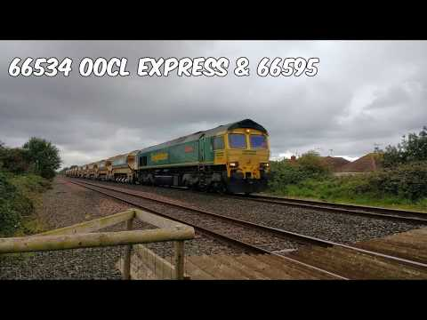 Freightliner 66534 & 66595 with auto ballasters pass Prestat…