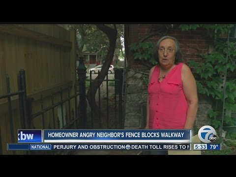 Homeowner angry neighbor's fence blocks walkway