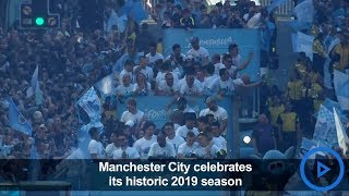 Manchester City celebrates football season titles with fans
