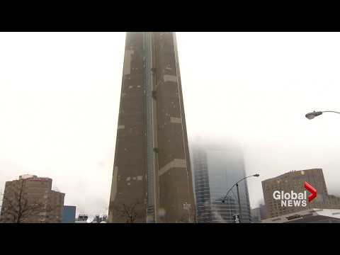 Ice falling from CN Tower caught on camera, causes damage to Rogers Centre