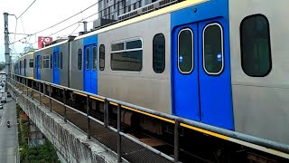 LRT-1/LRMC 3rd Generation (3G) train with Newly-Repainted Doors arriving Roosevelt Station