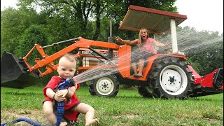 Playing in the mud and watering hay with tractors | Tractors for kids in the mud wheel fell off