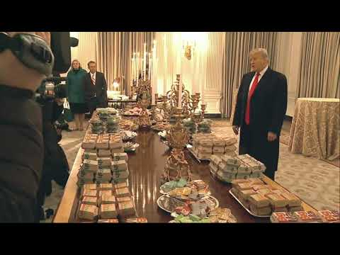 President Donald Trump paid tribute to Clemson's football team for winning the national college championship at the White House Monday evening. Trump honored the players with a fast food feast that included hamburgers, pizza and french fries. (Jan. 15)