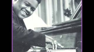 Fats Domino.  It keeps raining .