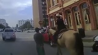 video: Bodycam video released of mounted Texas police leading black man through streets on a rope