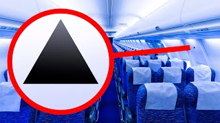 What a Tiny Triangle Above Your Plane Seat Means
