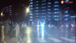 20180704_Stomp_Naked man braves heavy rain to cross road in Serangoon