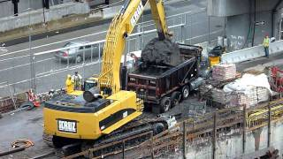 CAT 385C  excavator loading a dump truck [HD]
